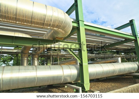 Big tube and green iron structure - stock photo