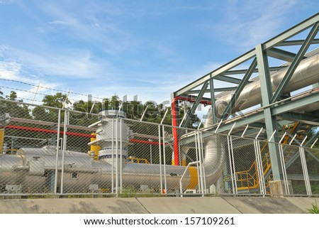 Big tube and iron structure in sunshine day - stock photo