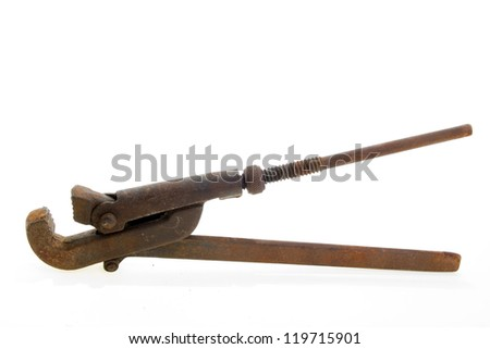 Big used rusty wrench on white background.