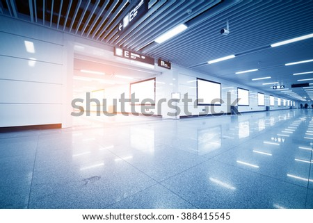 big vertical poster on metro station - stock photo