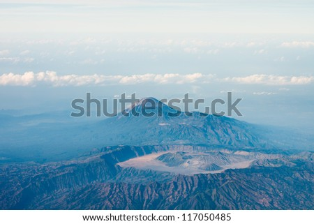 Big volcano crater with other volcano top on background, bird's eye view. Java island, Indonesia - stock photo