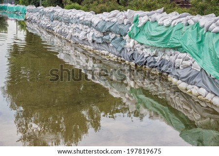 Big wall of sandbags for flood defense, sandbag barricaded - stock photo