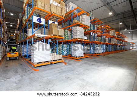 Big warehouse interior with forklift in row - stock photo