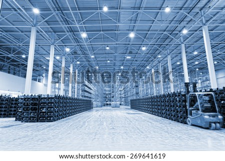 Big warehouse on storage of the packed mineral water - stock photo