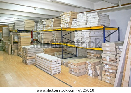 Big warehouse storage room with boxes and shelves