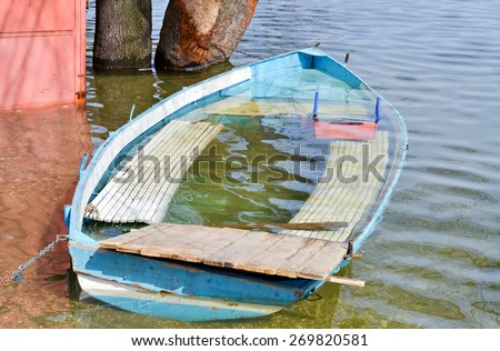 Big water and flooded boat after the storm and heavy rains - stock photo