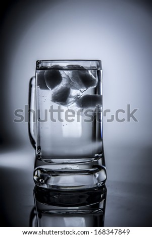 Big water glass with ice