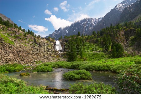 Big waterfall and mountain. Altay. Russia. - stock photo