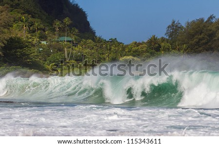 Big wave and rough ocean at Tunnels beach at Kauai - stock photo