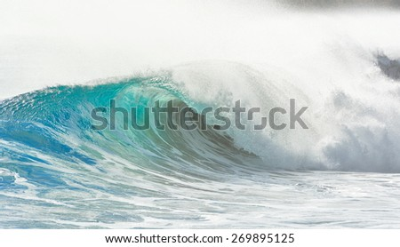 big wave breaking at shore - summer background - stock photo