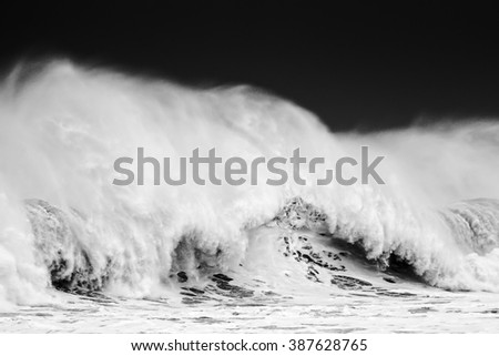 big wave breaking in black and white - stock photo