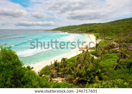 Big waves at Grande Anse beach, La Digue Island, Seyshelles - stock photo