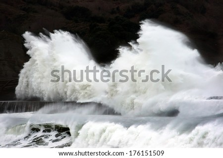 big waves breaking on a breakwater - stock photo
