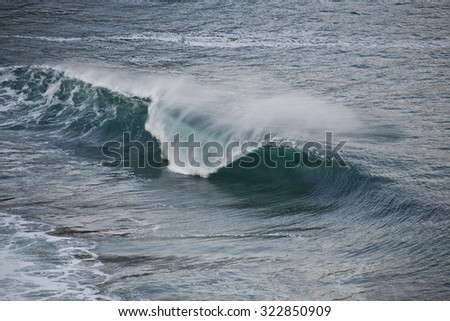 Big waves breaking on the shore. - stock photo