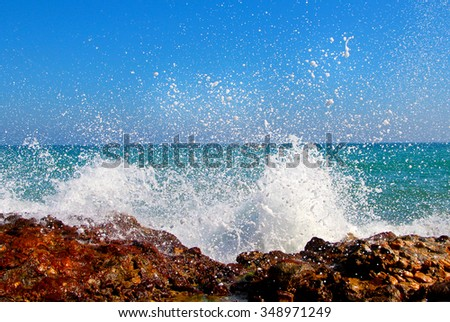 Big waves breaking on the shore with sea foam. - stock photo