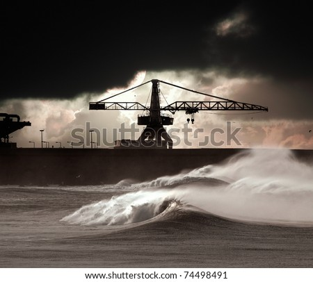 Big waves during a storm in the Portuguese coast - north side of Leixoes harbor - Porto (enhanced sky) - stock photo