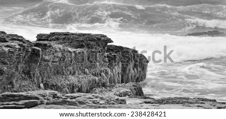 Big waves hitting the rock by the ocean - stock photo