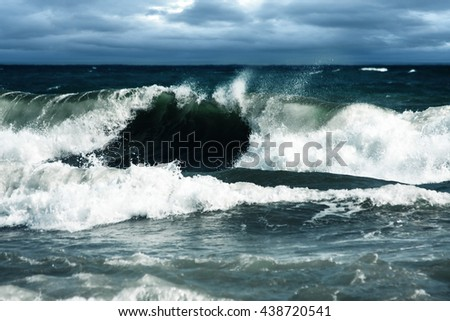 Big Waves Raised by Storm Breaking at Shore - stock photo