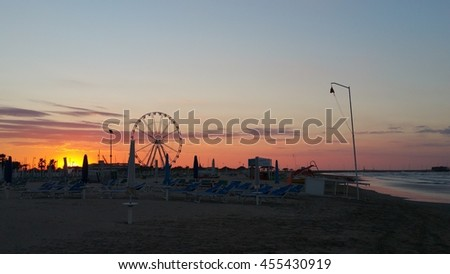 big wheel on rimini beach at sunset