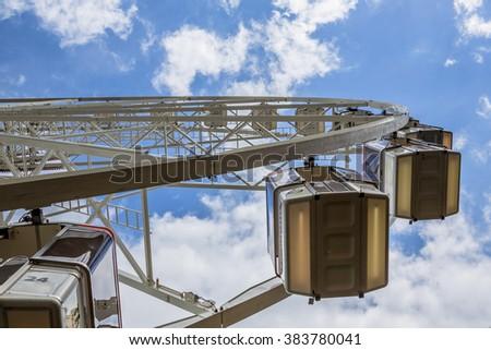 Big wheel seen from below on a funfair under summer sky - stock photo