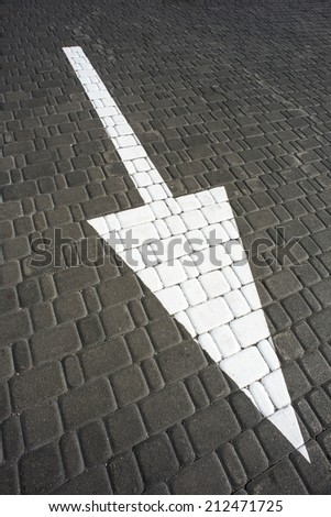 Big white arrow on the road - stock photo