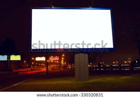 Big white billboard on night street - stock photo