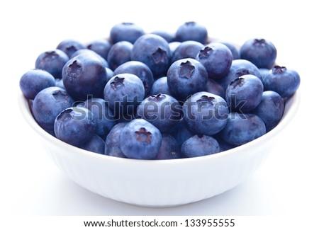 Big White Bowl Full of Ripe Blueberries on the White Background - stock photo