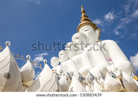 Big white buddha image with blue sky in background,horizontal