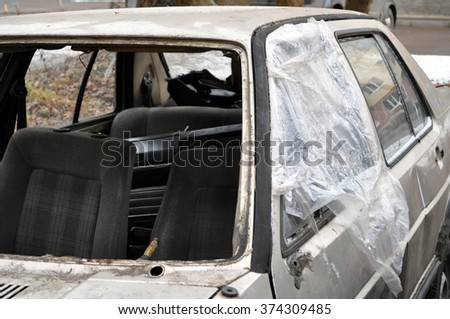big white car window smashed by a thief  - stock photo