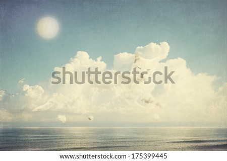 Big white cat floating in a cloud. Fantasy landscape  - stock photo
