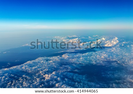 Big white cloud and blue sky background,view from airplane, earth view, blue and white clouds - stock photo
