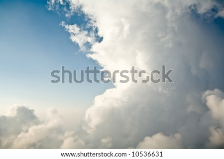 Big white clouds in a blue sky - stock photo