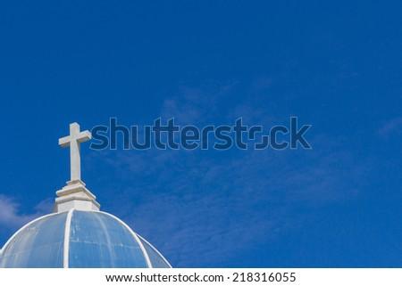 big white cross on blue sky - stock photo