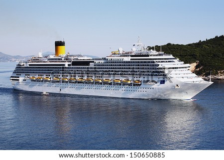 Big white cruise ship in a harbor - stock photo