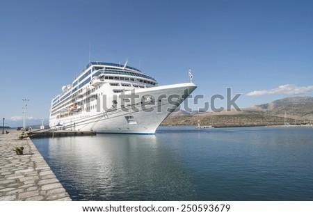 Big white cruise ship. Synny day. Greece - stock photo
