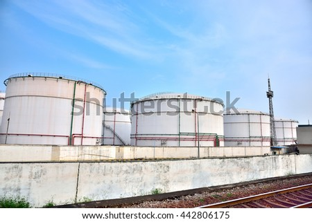 Big white gasoline and oil industry of storage tanks in the blue sky white cloud background