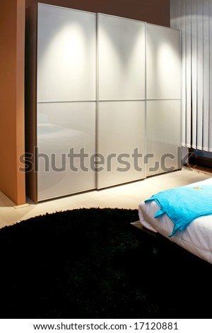 Big white minimalism style dresser in bedroom - stock photo