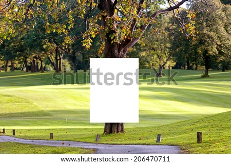 Big white poster on the tree in the public park. - stock photo