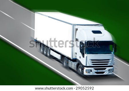 Big White Truck Moving on the Highway - stock photo