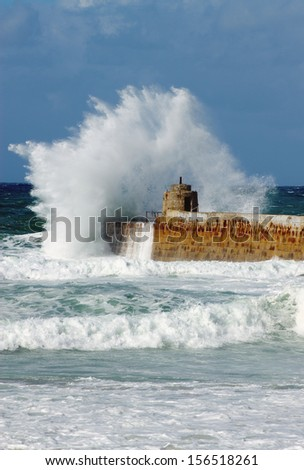 Big white water wave splash, Portreath pier, Cornwall England. - stock photo