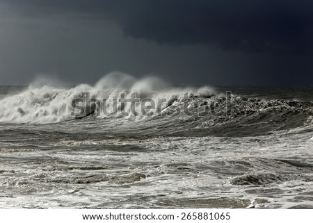 Big white wave approaching the portuguese coast before rain and storm - stock photo