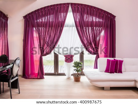 big window with elegant drapes and curtain