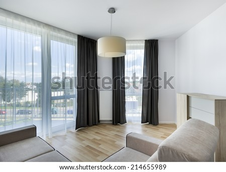Big windows in modern living room apartment interior design - stock photo