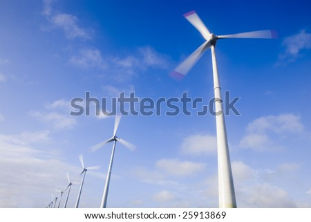 big winds turbines on the blue sky
