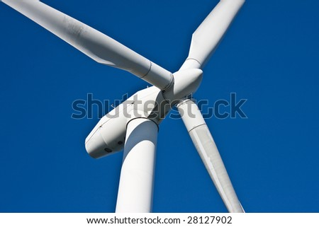 Big windturbine against a blue sky - stock photo