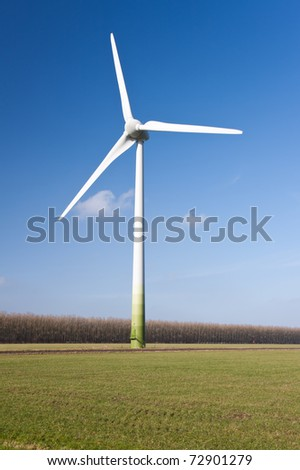 Big windturbine in the grassland of Flevoland, the Netherlands - stock photo