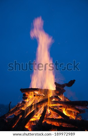 Big winter camp fire at night. - stock photo