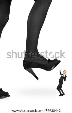 Big woman shoe stepping on a businesswoman isolated on white background - stock photo