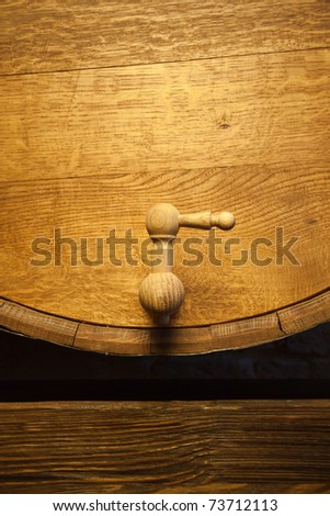 Big wood barrel with faucet in old wines cellar