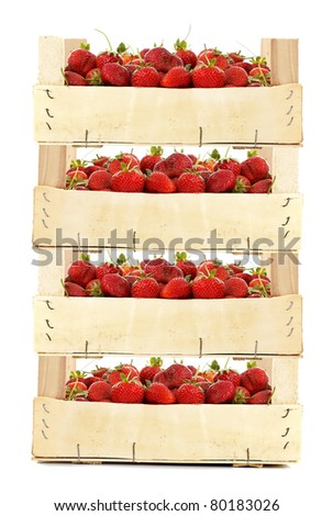 Big wooden boxes with fresh strawberries isolated on white background - stock photo